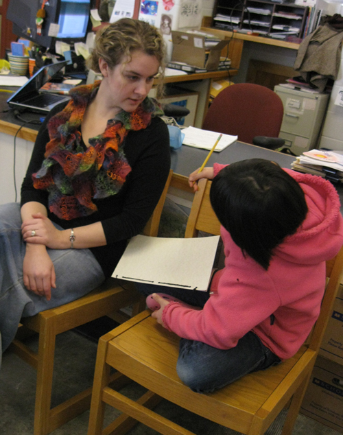 Children's book author Erin Moulton with a student in Moretown, Vermont